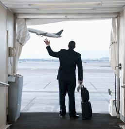 Man waving to airplane