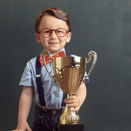 Kid_w_Trophy_croped-617112-edited