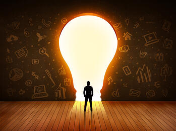 Business man looking at bright light bulb in the wall concept-1