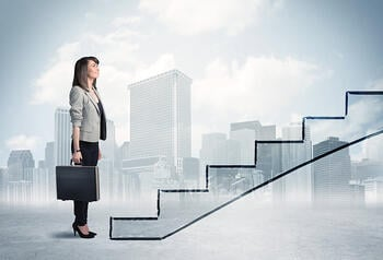 Business person in front of a staircase, city on the background-1