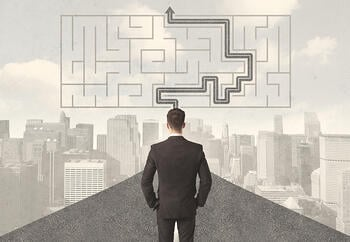 Businessman looking at road with maze and solution concept-1