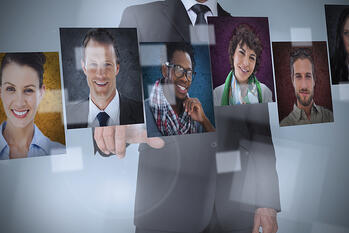 Businessman presenting profile pictures on digital interface-1