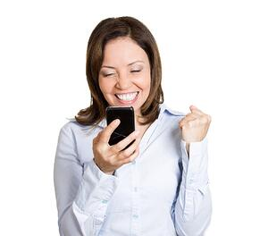Closeup portrait, happy, cheerful, mature woman, excited by what she sees on his cell phone, isolated white background. Positive human emotions, facial expression, feelings, reaction