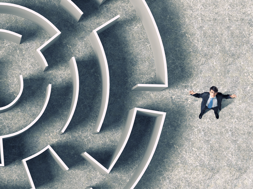 Top view of successful businessman standing near the entrance of labyrinth-2