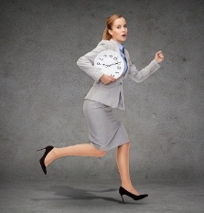 Woman running with clock